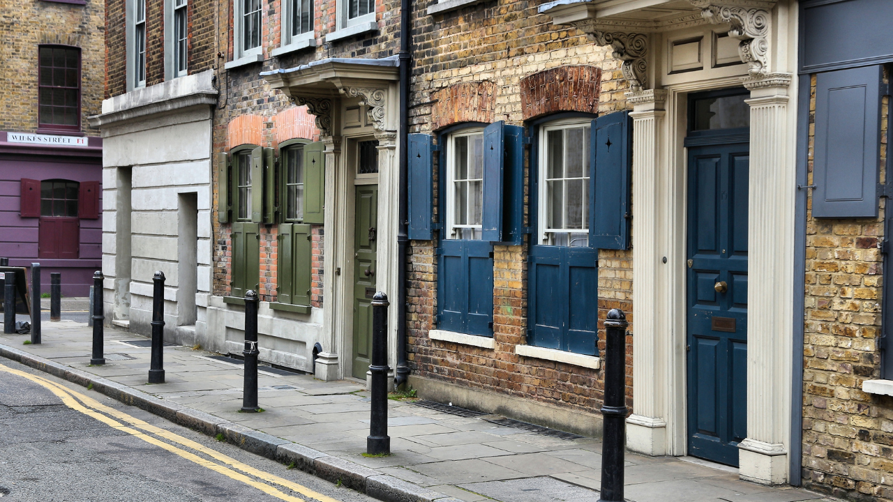 street houses with blue and green windows and doors in shoreditch street in london