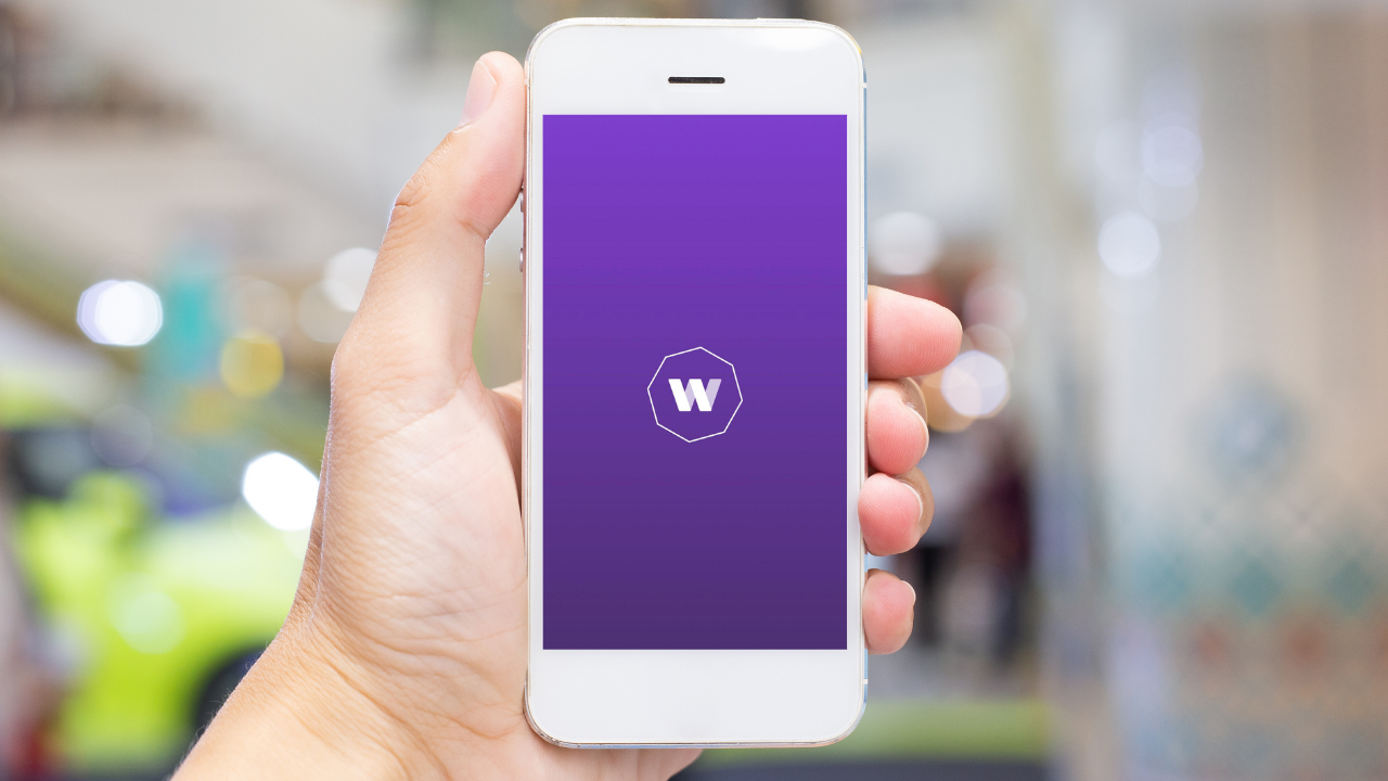 a hand holding a phone with worldremit app opened
