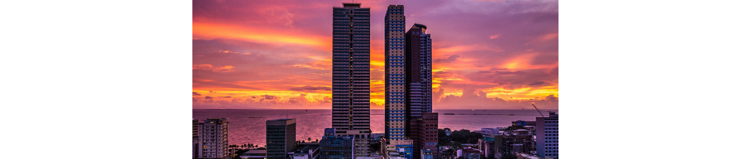 Photom of buildings and skyline in Manila at sunset