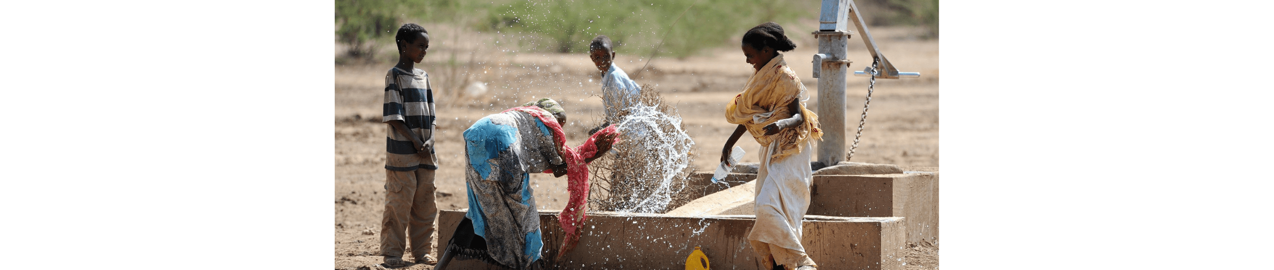 A group of African women playing with water.